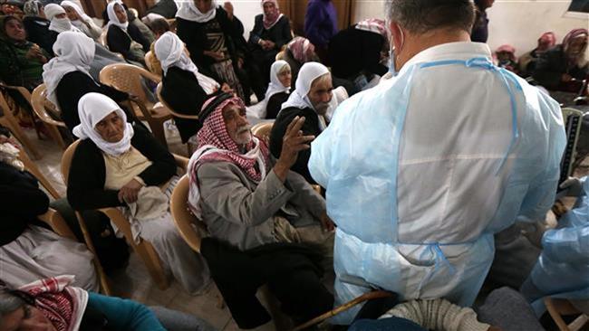 Az orvosok az jazidi embereket az iraki al-Tun Kopri egészségügyi központban látják el, miután kiszabadultak az ISIL fogságából.