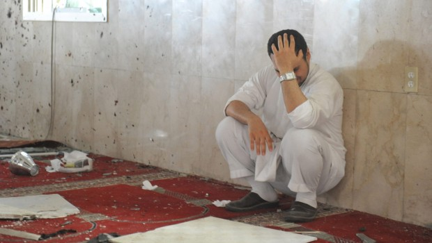 A family member of a slain victim mourns after arriving at the Imam Ali mosque, the site of a suicide bomb attack, in the village of al-Qadeeh in the eastern province of Gatif