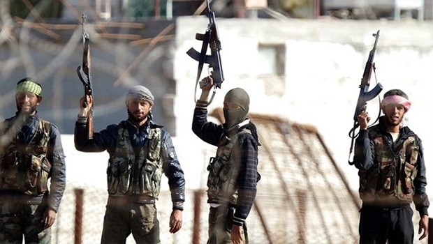US-Trained Rebels Give up Arms to al-Nusra Front after Entering Syria