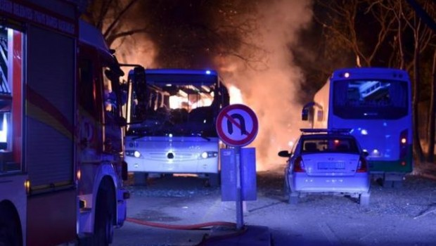 A vehicle of firefighters is parked next to the explosion site in Ankara