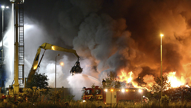 Firefighters work to extinguish flames after a massive blaze torched a recycling station in Malmo, Southern Sweden June 27, 2013. The fire broke out on Thursday evening around 7 pm local time in the area of Norra Hamnen. No casualties were reported. Picture taken June 27, 2013. REUTERS/Johan Nilsson/Scanpix Sweden (SWEDEN - Tags: DISASTER TPX IMAGES OF THE DAY) ATTENTION EDITORS - THIS IMAGE WAS PROVIDED BY A THIRD PARTY. FOR EDITORIAL USE ONLY. NOT FOR SALE FOR MARKETING OR ADVERTISING CAMPAIGNS. THIS PICTURE IS DISTRIBUTED EXACTLY AS RECEIVED BY REUTERS, AS A SERVICE TO CLIENTS.  NO COMMERCIAL SALES. SWEDEN OUT. NO COMMERCIAL OR EDITORIAL SALES IN SWEDEN - RTX114IN