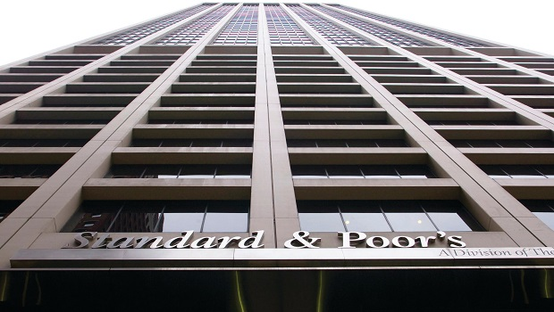 The Standard and Poor's sign hangs from their building headquarters in New York on Friday, Mar. 6, 2009. Photographer: Jin Lee/Bloomberg News