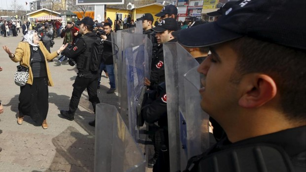 A demonstrator argues with Turkish riot police during a protest ahead of the International Women's Day, in Istanbul