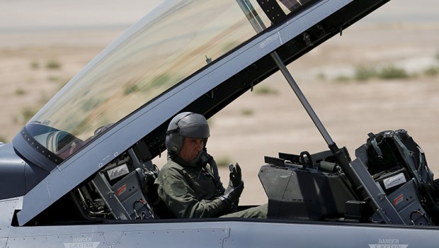 Iraq's Defence Minister Khaled al-Obeidi sits in a F-16 fighter jet, during an official ceremony to receive four of these aircrafts from the U.S., at a military base in Balad, Iraq, July 20, 2015. REUTERS/Thaier Al-Sudani - RTX1L2B3