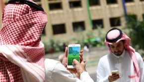 Saudi men play with the Pokemon Go application on their mobiles in the capital Riyadh  on July 17, 2016.  / AFP / STRINGER        (Photo credit should read STRINGER/AFP/Getty Images)