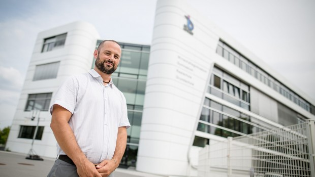 Alexander Fenselau, teacher at the private Turkish Bil school, posing in front of the school building in Stuttgart, Germany, 22 July 2016. After the attempted coup in Turkey, the school associated with the Guelen movement is protected by the police. Officers control the school irregularily. PHOTO: CHRISTOPH SCHMIDT/dpa
