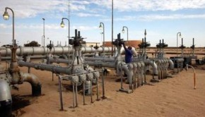 A worker checks pipes and valves at Amaal oil field in eastern Libya October 7, 2011. REUTERS/Ismail Zitouny