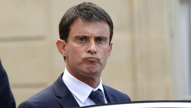 French Prime Minister Manuel Valls leaves the Elysee Palace in Paris on July 24, 2014, after meeting with the French president and his cabinet regarding an Air Algerie plane with about 110 passengers, including 51 French nationals, which went missing after taking off from Burkina Faso for Algiers. A source in Mali said that contact with the McDonnell Douglas MD-83 was lost over Gao in north Mali, a region that was seized by jihadists groups for several months in 2012 and that remains very unstable despite the Islamists being driven out in a French-led offensive. Hollande vowed on July 24 to use 'all military means' in Mali to search for Algerian plane.  AFP PHOTO / BERTRAND GUAY