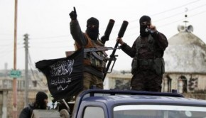 Members of al Qaeda's Nusra Front gesture as they drive in a convoy touring villages, which they said they have seized control of from Syrian rebel factions, in the southern countryside of Idlib, December 2, 2014. REUTERS/Khalil Ashawi