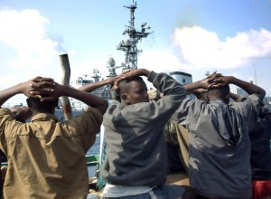 This handout photo released by the French Ministry of Defense on January 4, 2009 shows presumed Somalian pirates who were arrested by French soldiers in the Gulf of Aden. A French warship foiled attempts on January 4, 2009, by Somalian pirates in the Gulf of Aden to seize two cargo vessels and intercepted 19 people, the French president's office said.  The French defence ministry said pirates attempted to attack a Croatian and a Panamanian ship and that French forces seized assault rifles, two rocket launchers, and more than 1,000 litres of oil. AFP PHOTO MINISTERE DE LA DEFENSE / AFP PHOTO / MINISTERE DE LA DEFENSE