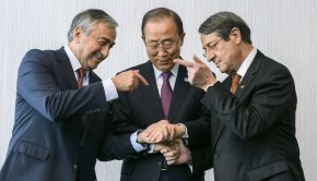 United Nations Secretary-General Ban Ki-Moon (C) prepares to handshake with Turkish Cypriot leader Mustafa Akinci (L) and Greek Cypriot President Nicos Anastasiades at the start of Cyprus Peace Talks on November 7, 2016 in Mont Pelerin, Western Switzerland where Cyprus' Greek and Turkish speaking communities will conduct a key phase of reunification talks, under the aegis of the United Nations Prospect of Cyprus solution 'within reach'said UN chief Ban Ki-Moon on November 7, 2016. / AFP PHOTO / POOL / FABRICE COFFRINI